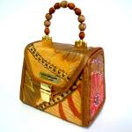 Sew craftsy purses. Student R. Thompson.