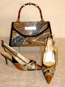 Online student D. Edwards Handbag making designer purses with custom painted fabrics.