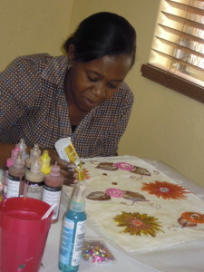Student learning how to paint on fabric.