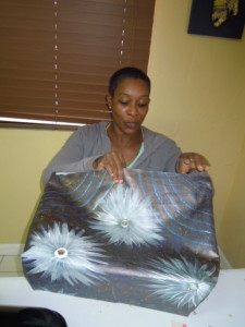 Lemongrass Designs- Cenita Duncombe makes a tote bag with her custom painted fabric.