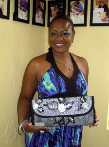 Clutch Purse Making Class- Student Alayna Evans with her custom painted clutch purse.