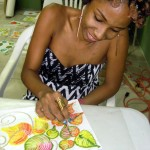 Student learning to paint textured floral designs